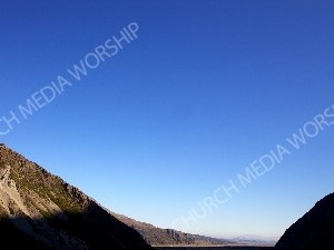 Valley Beyond the Mountains Christian Worship Background. High quality worship images for use to spread the Gospel and enhance the worship experience.