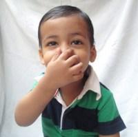 Devansh_smell_boy_holding_nose.jpg