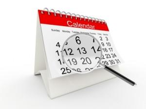 Calendar under magnifying glass