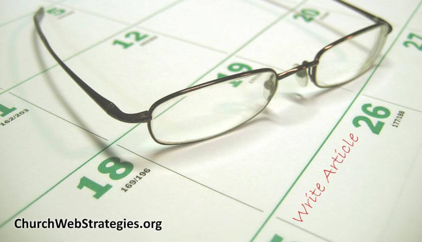 glasses sitting on desktop paper calendar