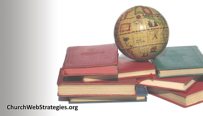 small old globe sitting on top of a stack of books