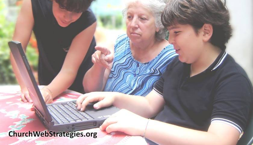 young boys helping grandmother with laptop