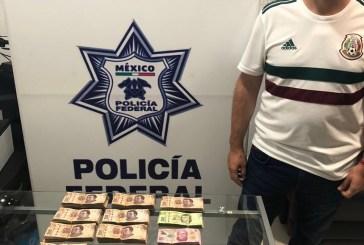 Detienen en aeropuerto de Cancún a pasajero con casi medio millón de pesos