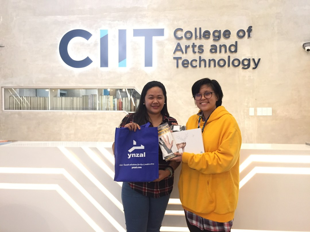 April Sanico receives her award for On-the-Spot Drawing Contest