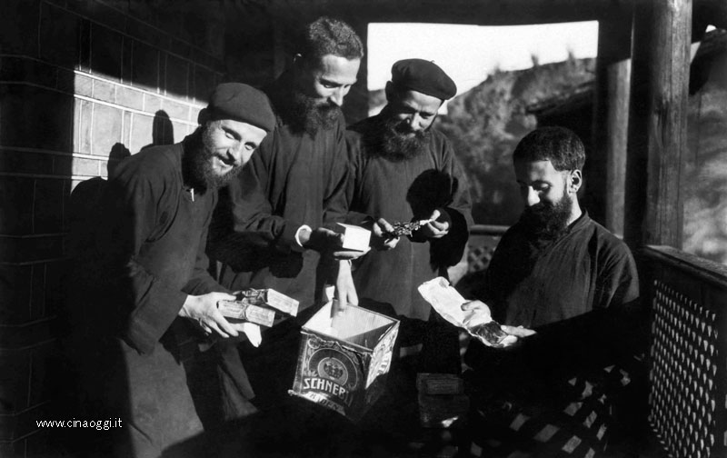 Missionaries in the Weixi mission open parcels from Europe