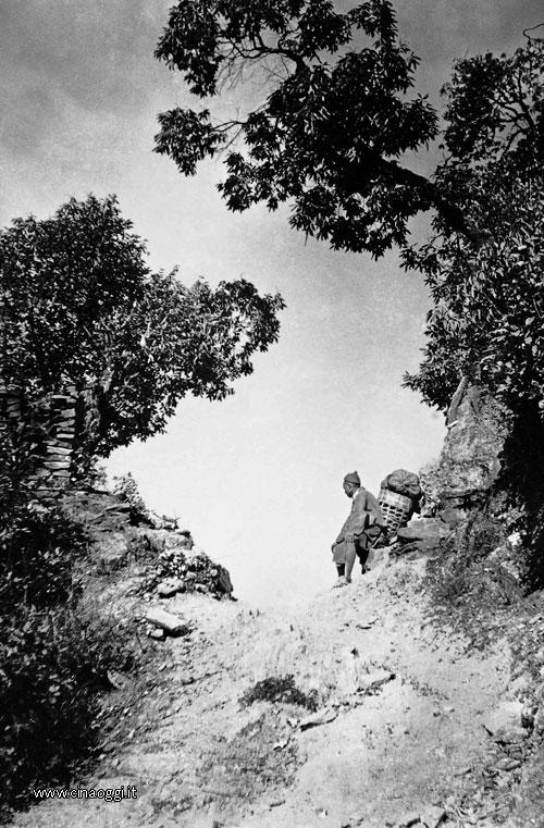 A porter rests against his pannier