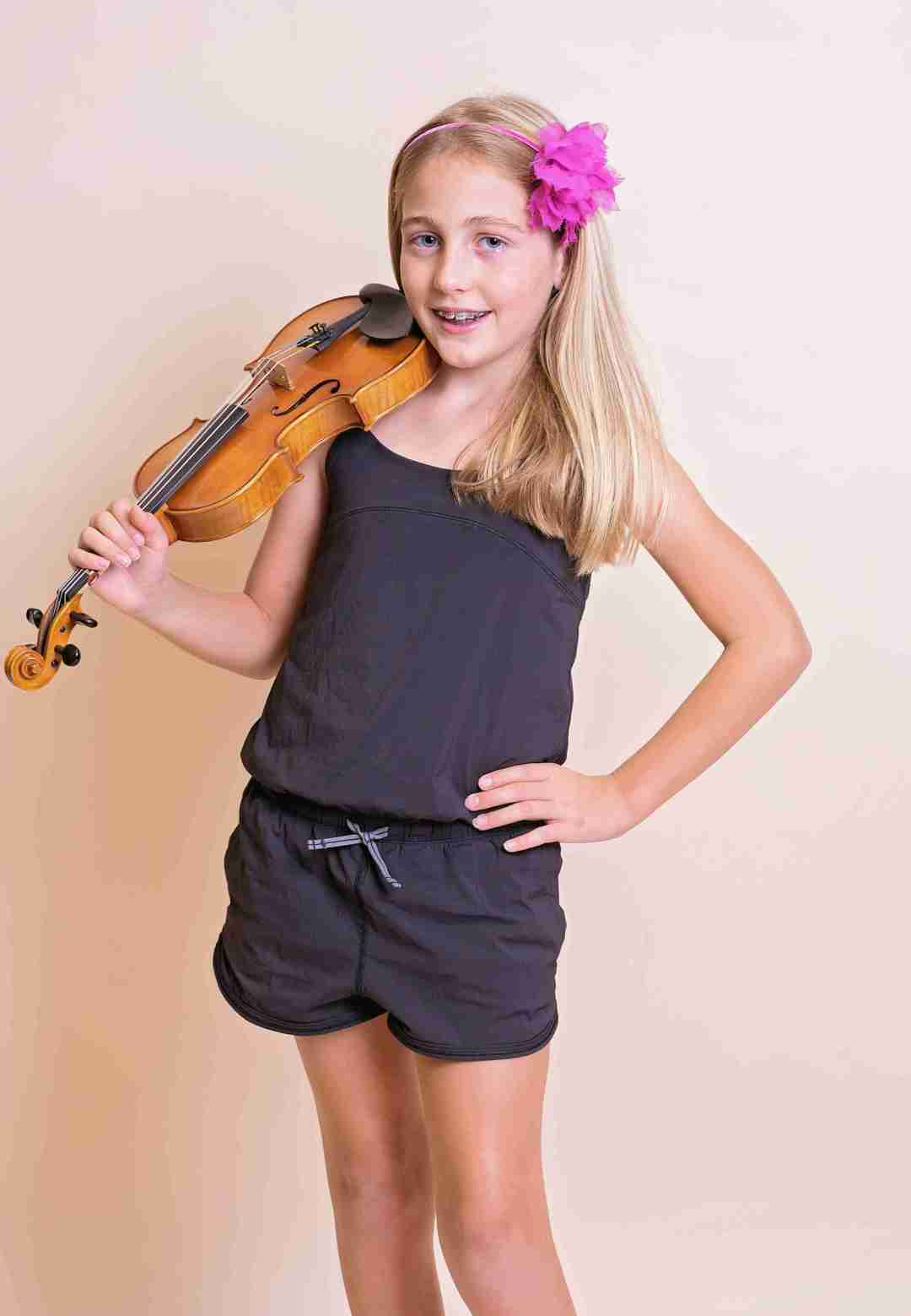 Happy violin student at The Conservatory of Music kn Katy, TX
