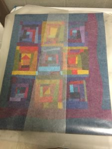 Wax Paper protects the quilt - Cindy Grisdela