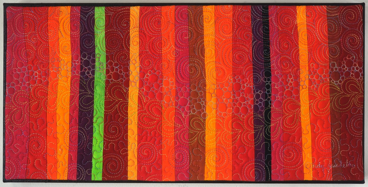 Aurora Art Quilt in warm reds -Cindy Grisdela