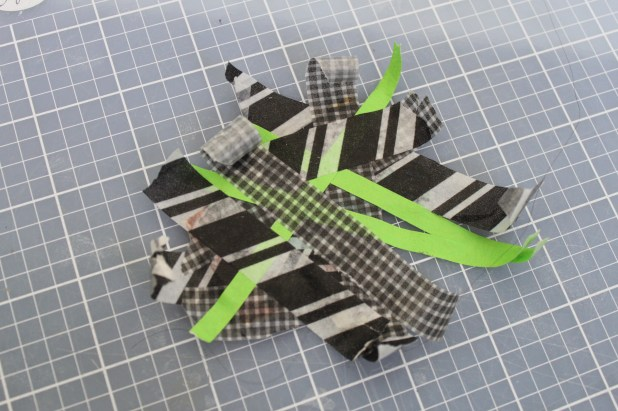 tape covered puzzle piece