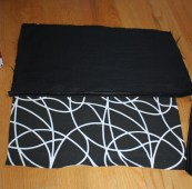 The swirly fabric will be the finished front. I laid one side of the black down with the finished seam down the middle.