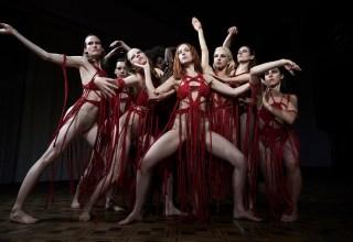 Dakota Johnson (center) and Mia Goth (center-left) star in Amazon Studios' SUSPIRIA