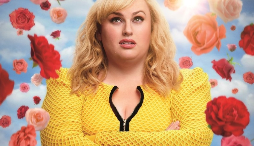 Poster image featuring Rebel Wilson for Warner Bros. Pictures' ISN'T IT ROMANTIC