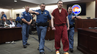 CENTENNIAL, CO - AUGUST 26: James Holmes is led out of the courtroom after being formally sentenced. The formal sentencing concluded on Wednesday at Arapahoe County District Court in Centennial, CO on August 26, 2015. (Photo by RJ Sangosti/The Denver Post, POOL)
