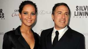 Jennifer Lawrence e David O. Russell | © Kevin Winter/Getty Images