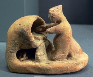 Antica miniatura greca di un forno e di un panettiere