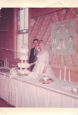 Young bride and groom in 1950s wedding photo.