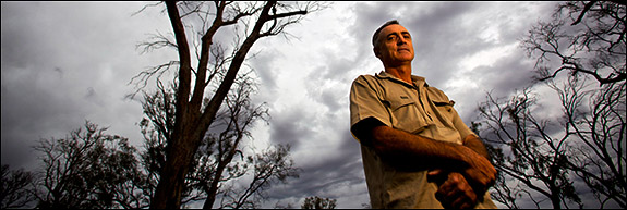 Once a farmer now a conservationist, Greg Ogle stands among Australia's giant red gum trees northwest of Swan Hill that the epic drought has killed. Use left and right arrows to navigate through all images.