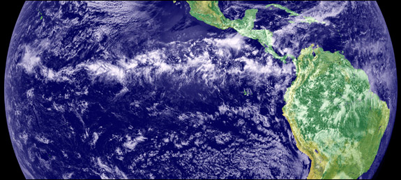 In the intertropical convergence zone, an area just north of the equator, northern and southern trade winds collide and form thick clouds as the tropical sun warms the atmosphere. This image is a combination of cloud data from NOAA's Geostationary Operational Environmental Satellite and color land cover classification data. Image courtesy of NASA/JPL.