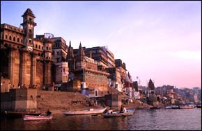 Sunrise in Varanasi brings the ritual morning prayer and washing.