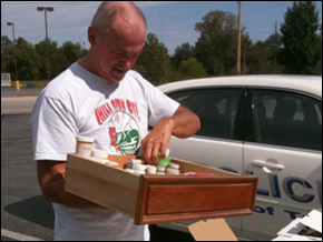 A man in Troy, Mo., brings a kitchen drawer filled with unused or expired medications to the Drug Enforcement Administration's first national drug take-back collection event.