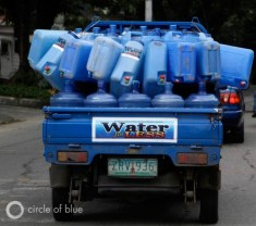 Refillable water containers Manila east Zone philippines privatization slum cuatro squatter village truck