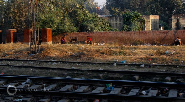 WASH India sanitation United Nations Millennium Development Goals delhi chandigarh train tracks slum squatter village open defecation pooping outside sewer raw sewage