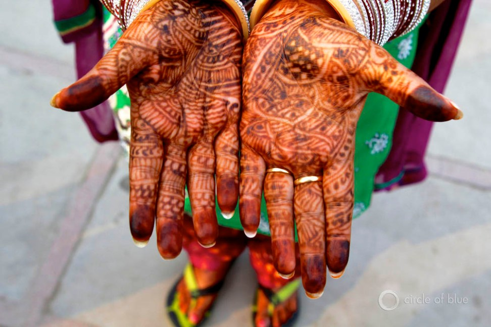 tradition India wedding Punjab Nawanshar Mandeep Sekhon family farm ceremony henna tattoo bangle rhinestone bracelet sari gold Choke Point India Circle of Blue Wilson Center