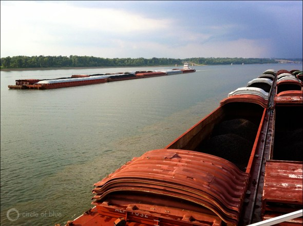 The volume of coal transported on the Ohio River dropped 10 percent in 2012 as utilities switched to burning more natural gas to generate electricity. Here two river tows pass on the Ohio River downstream from Paducah, KY.