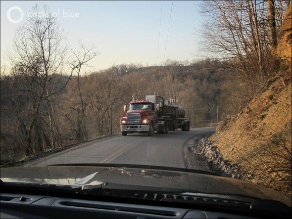 Water tankers hauling fracking fluids and wastewater from a shale gas drilling site in the hills along the Ohio River near Parkersburg, W. Va.