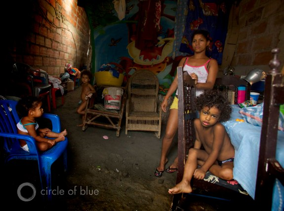 poverty sanitation clean drinking water Cartegena Colombia New Horizons El Pozon The Well slum squatter village family 2013 Creating Shared Value csv global forum j. carl ganter circle of blue