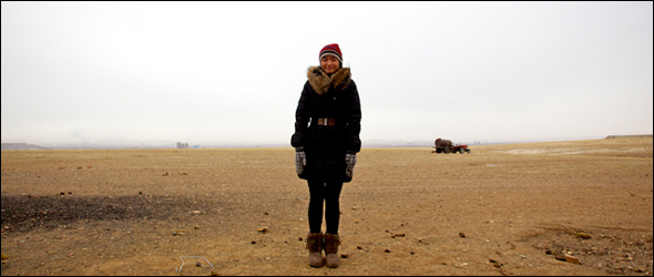 Two years ago, on a frigid December afternoon, Wu Yun stood outside her parents' farmstead near Xilinhot with tailing piles from the coal mines in the distance.