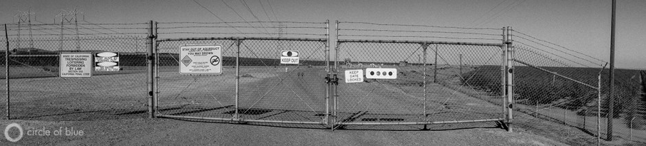 Gates block access to the California Aqueduct as it flows through the Central Valley.