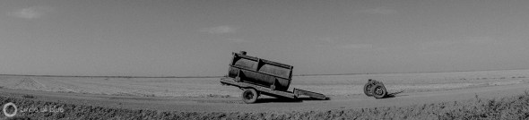A livestock water tank parked in a dry field in California's Central Valley.