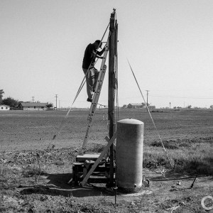 Dropping water tables and a shorted pump resulted in Louis Coronado's water well going dry. He said he was unable to contract a professional driller because they are busy drilling new wells for area farmers, so built this scaffolding and repaired the well himself.