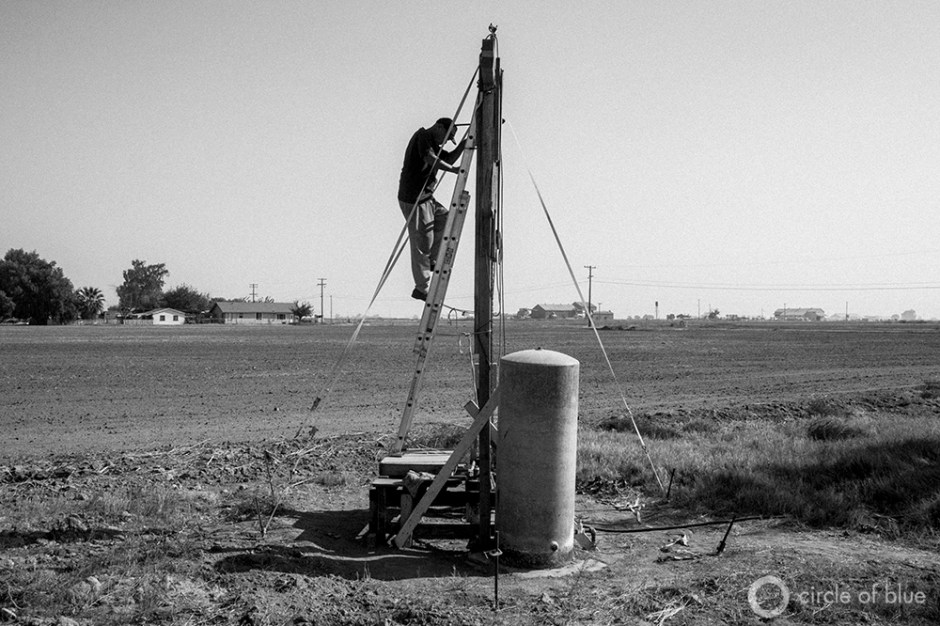 Dropping water tables and a shorted pump resulted in Louis Coronado's water well going dry. He said he was unable to contract a professional driller because they are busy drilling new wells for area farmers. So he built this scaffolding and repaired the well himself.
