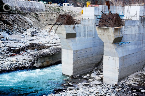 The 99-megawatt Singoli-Bhatwari Hydroelectric Project on the Mandakini River near Okund was so aggressively pummeled by floodwaters and boulders that big chunks of concrete were gouged out of its base and the patches of steel reinforcing rods of two support towers were bent like broken fingers. Photo: Dhruv Malhotra