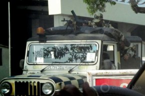 Manned machine gun nests and mobile military vehicles, armed with machine guns, eye travelers arriving and leaving the region's major airport in Guwahati, the capital of Assam.