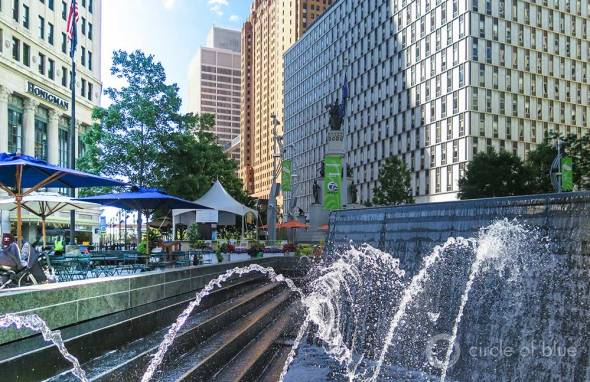 The fountain at Campus Martius in downtown Detroit symbolizes the city's location amid ample freshwater resources in the Great Lakes region of the United States. Water shutoffs for thousands of Detroit residents are not the result of scarcity. They are the culmination of urban deterioration, job loss, declining population, and mismanagement.