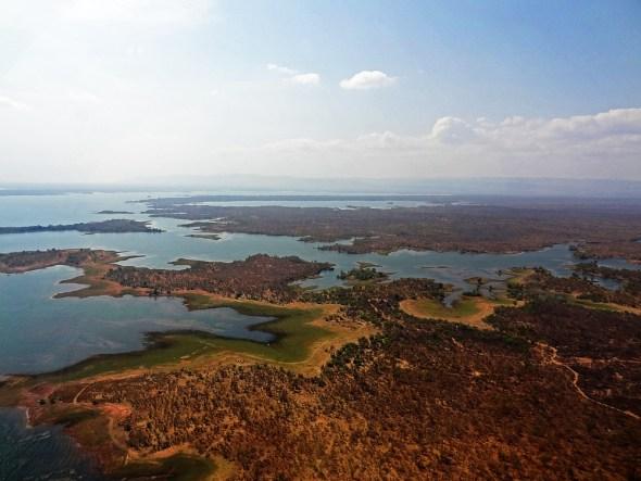 aerial Zambia Zimbabwe Lake Kariba Dam reservoir hydropower Zambezi River water levels drought electricity shortage Africa Allan Grey