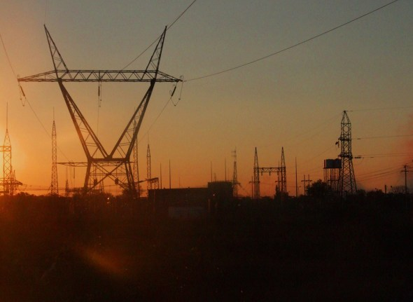 Zambia power lines electricity electrical grid hydropower electricity shortage energy Africa sunset John Mauremootoo
