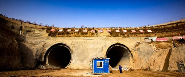 Photo © Aaron Jaffe / Circle of Blue The dark openings of two pipelines beneath the Yellow River, like eyes on a flat face of dirt and rock, are unblinking witnesses to the South-North Water Transfer Project.