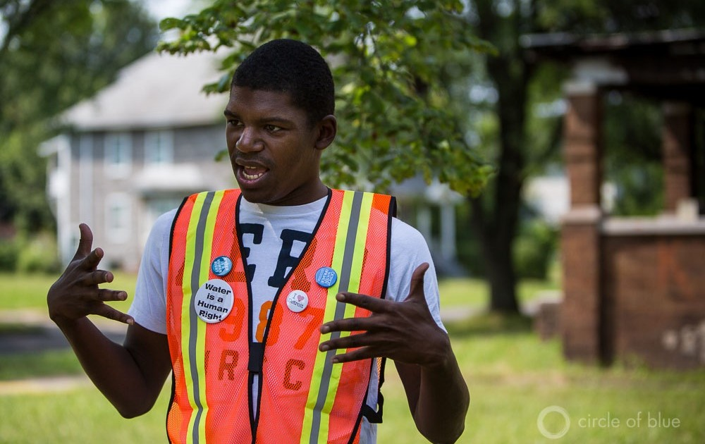 DeMeeko Williams works with the Detroit Water Brigade, a community response group that works to bring emergency relief to families who face water shut-offs. In this August 2014 photo, Williams describes taking calls for weeks over the summer, when thousands of families had water service cut off.