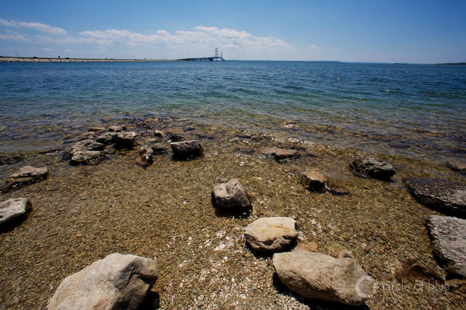 Studies have estimated that as many as 1,000 kilometers of Lake Michigan and Lake Huron shoreline are vulnerable to an oil spill from the Line 5 straits crossing, though Enbridge disputes those findings.  Photo © J. Carl Ganter / Circle of Blue