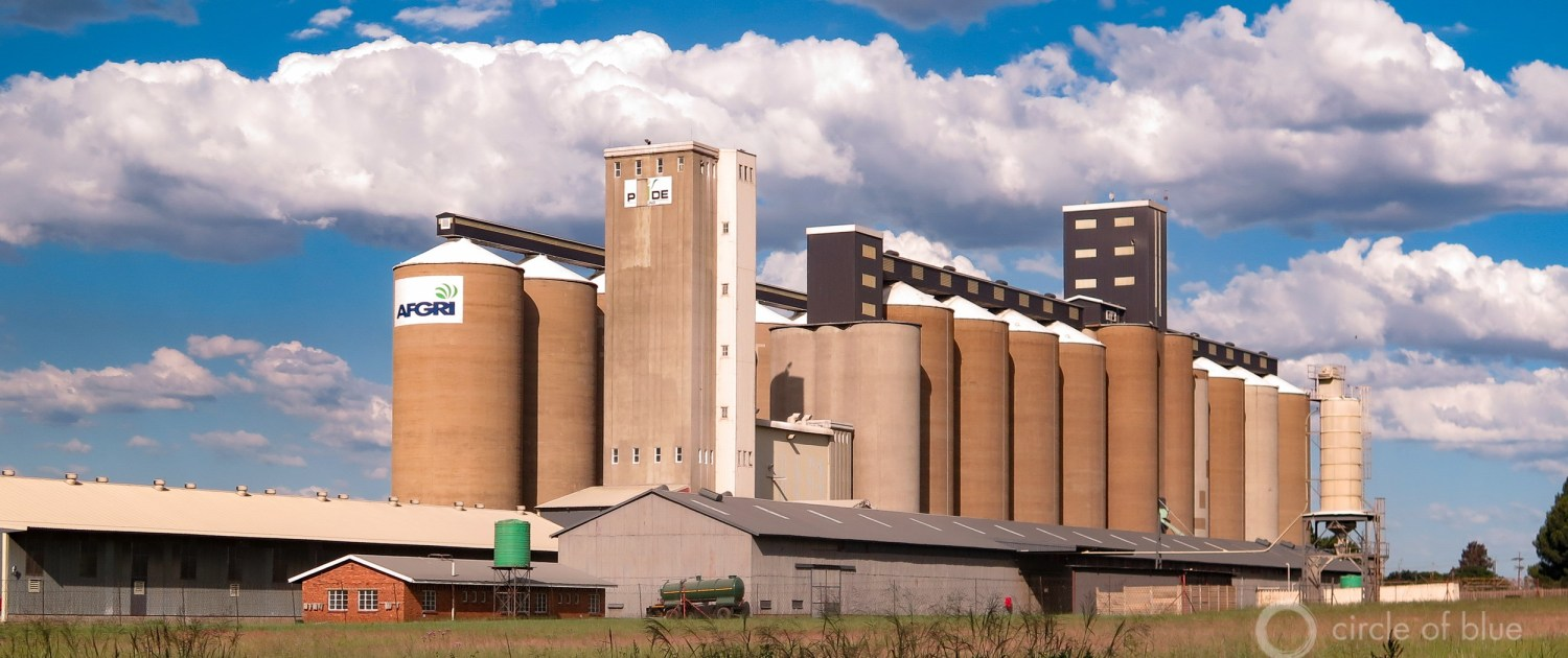 Grain elevators rise above farm fields in Mpumalanga province, in northeastern South Africa. Africa's largest grain producer will import maize this year due to the worst drought in more than three decades. Photo © Keith Schneider / Circle of Blue
