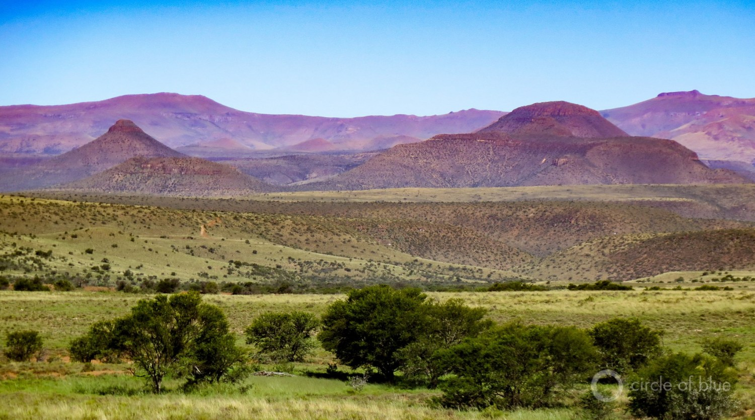 Thinly populated, with towns hours distant from one another, the Karoo's hot desert extends to the sides of mammoth tabletop ridges that turn purple at dusk. This canvas of color and light, of rock and mountain and glorious sunsets, has inspired generations of South African poets and artists. Photo © Keith Schneider / Circle of Blue