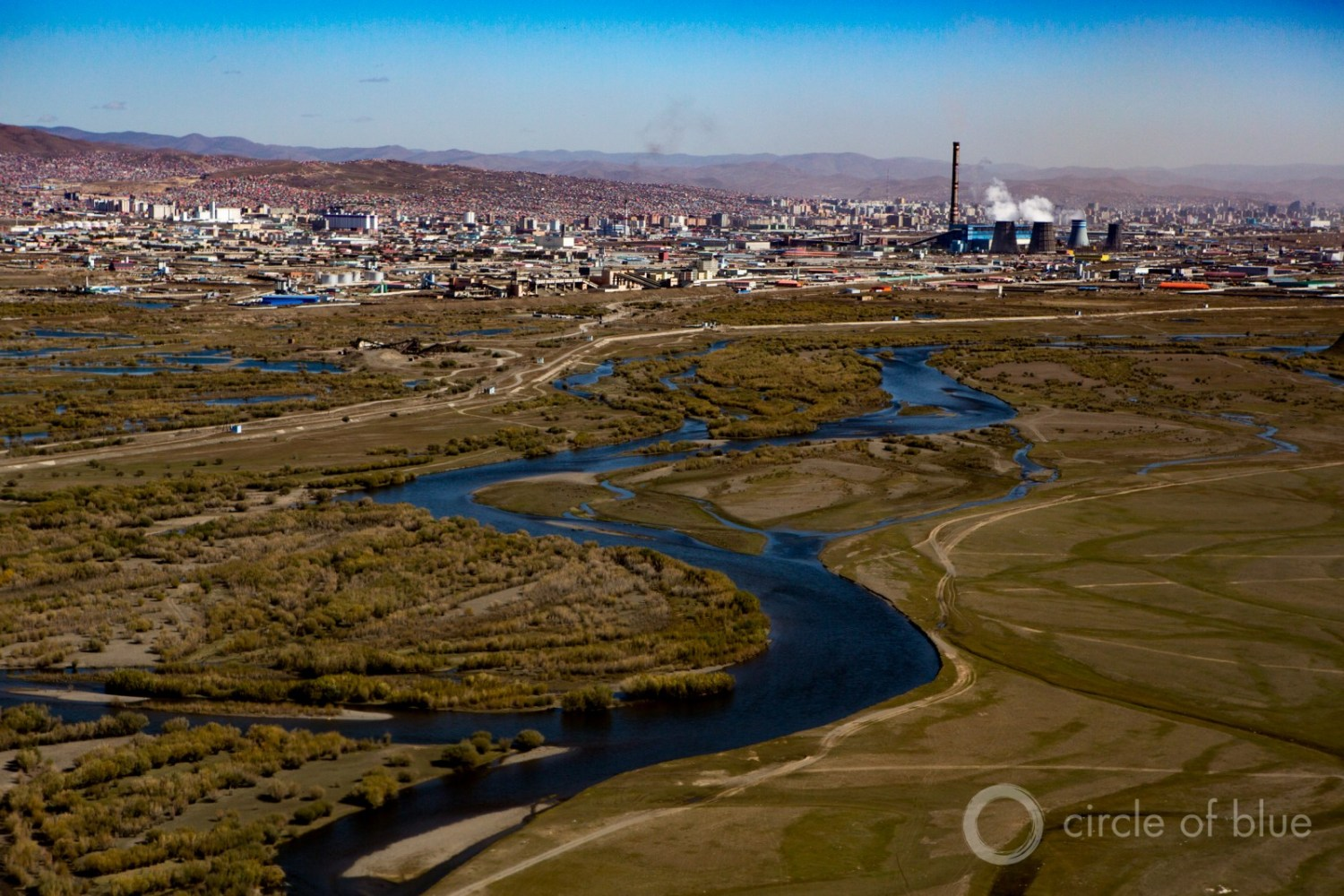 "Coal-fired power in Ulan Bator, Mongolia. Much of the analysis on financial losses focuses on the plunge in oil and coal prices, and the potential that a huge portion of the global reserves of oil, gas, and coal will be ""stranded' in the ground to curb climate change. Photo © J. Carl Ganter / Circle of Blue"