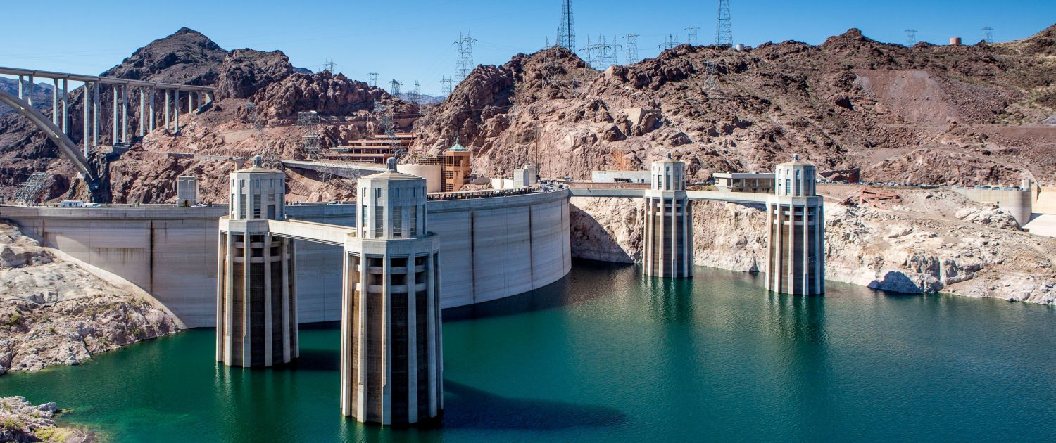 Power lines sweep outward from Hoover Dam, the largest hydropower facility in the U.S. Southwest. Because water levels in Lake Mead have plummeted, power customers have invested in equipment upgrades that will keep the dam operating in low-water conditions. Photo © J. Carl Ganter