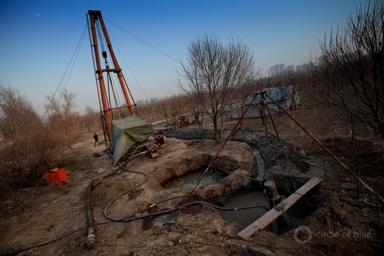A community in Hebei Province, just outside of Beijing, drills for water to replace a dry well. The proliferation of such wells in the Beijing region is causing the land to sink, a process called subsidence. Photo © Aaron Jaffe / Circle of Blue