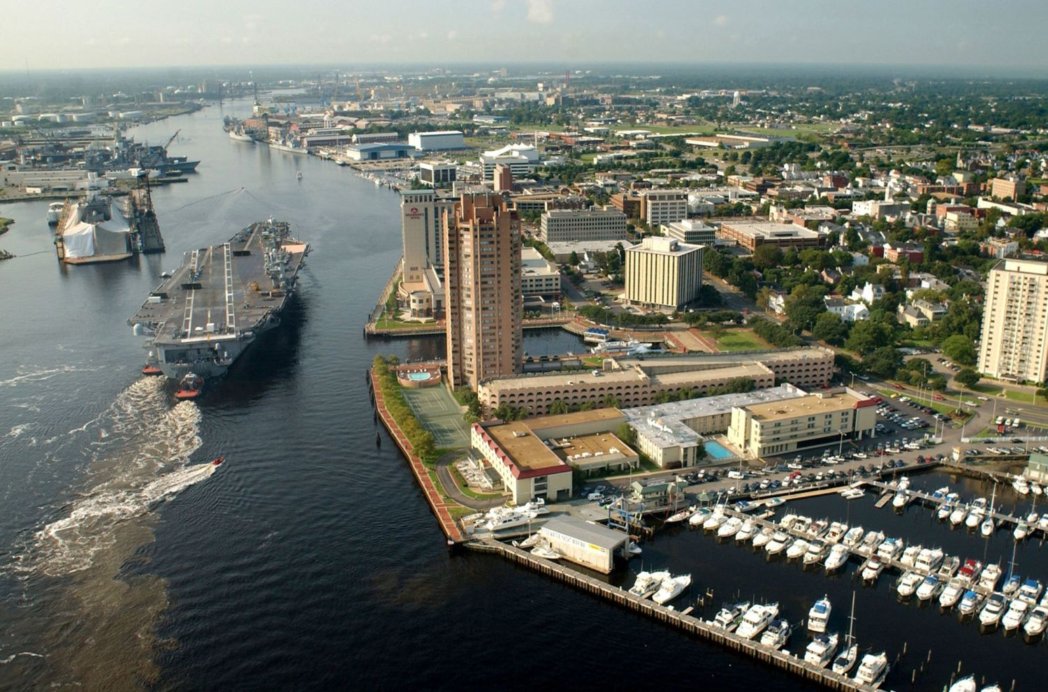 The Elizabeth River passes by Portsmouth, Virginia, before draining into the Chesapeake Bay. Portsmouth has one of the highest rates of sea level rise on the East Coast. Photo via Wikimedia Commons